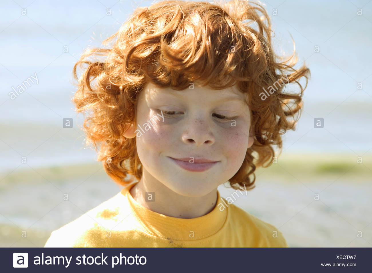 Portrait of a young red headed boy - Stock Image