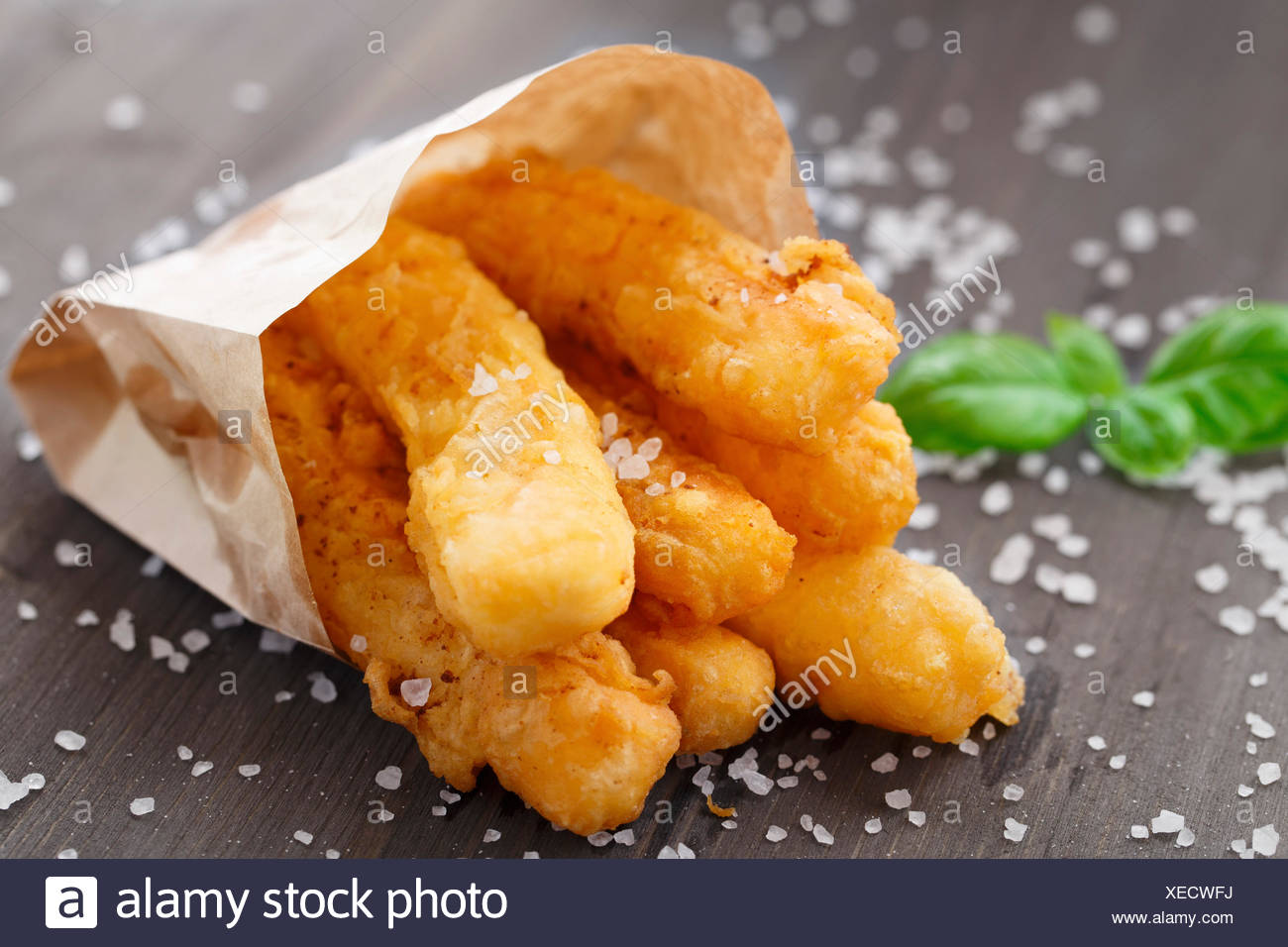 Delicious deep fried cheese sticks on a table - Stock Image