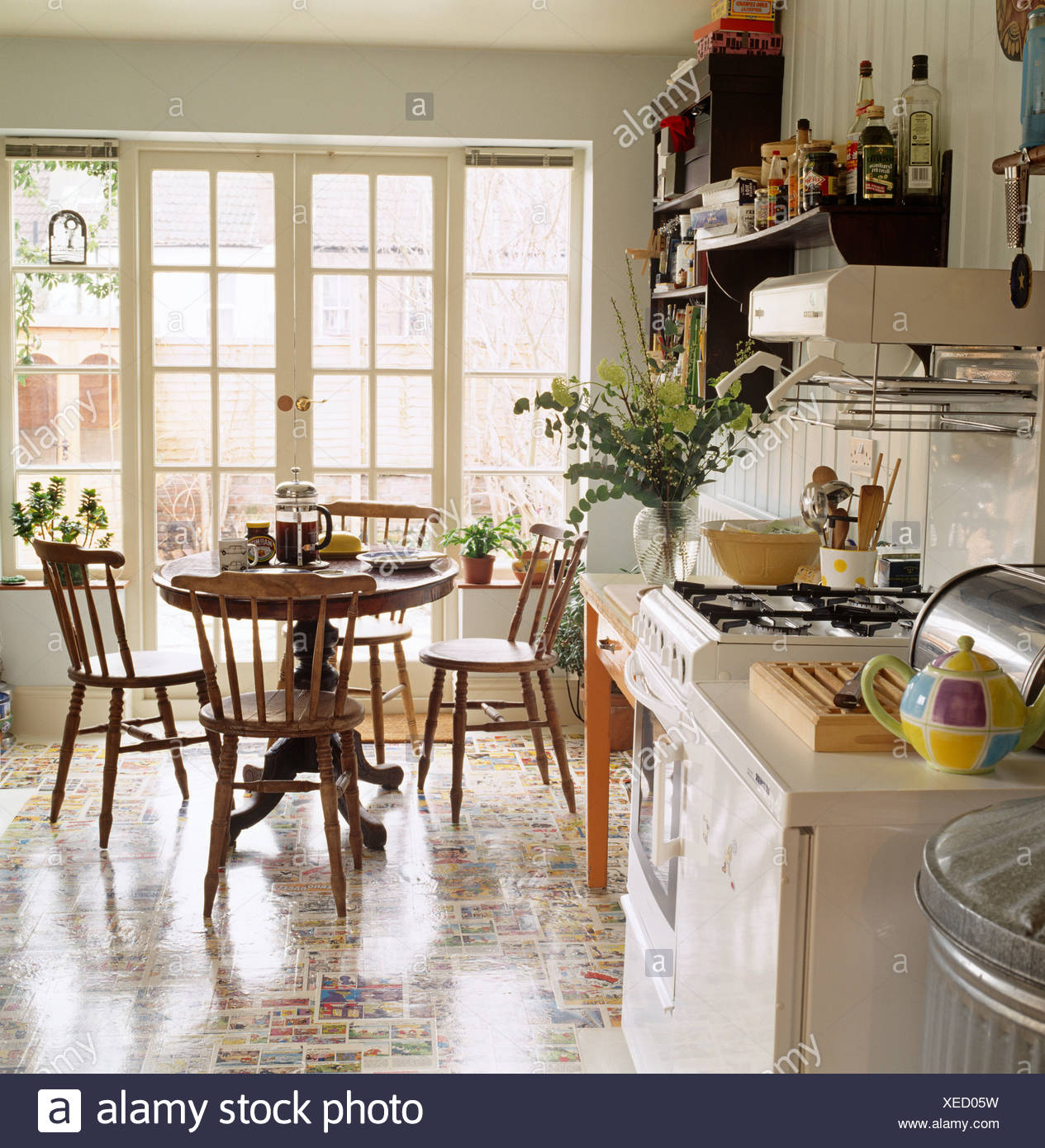 Colorful Flooring And Gas Oven In Kitchen Dining Room With Circular