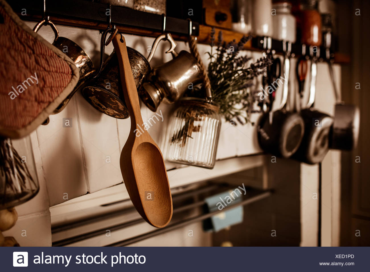 Kitchen utensils hanging on wall - Stock Image