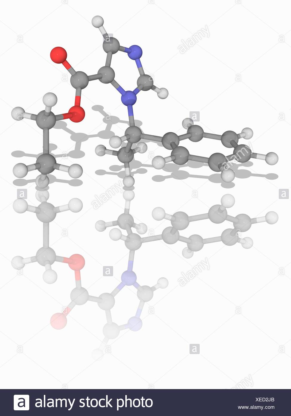 Etomidate. Molecular model of the drug etomidate (C14.H16.N2.O2), used as a short-acting intravenous anaesthetic agent for general anaesthesia and for sedation. Atoms are represented as spheres and are colour-coded: carbon (grey), hydrogen (white), nitrogen (blue) and oxygen (red). Illustration. - Stock Image