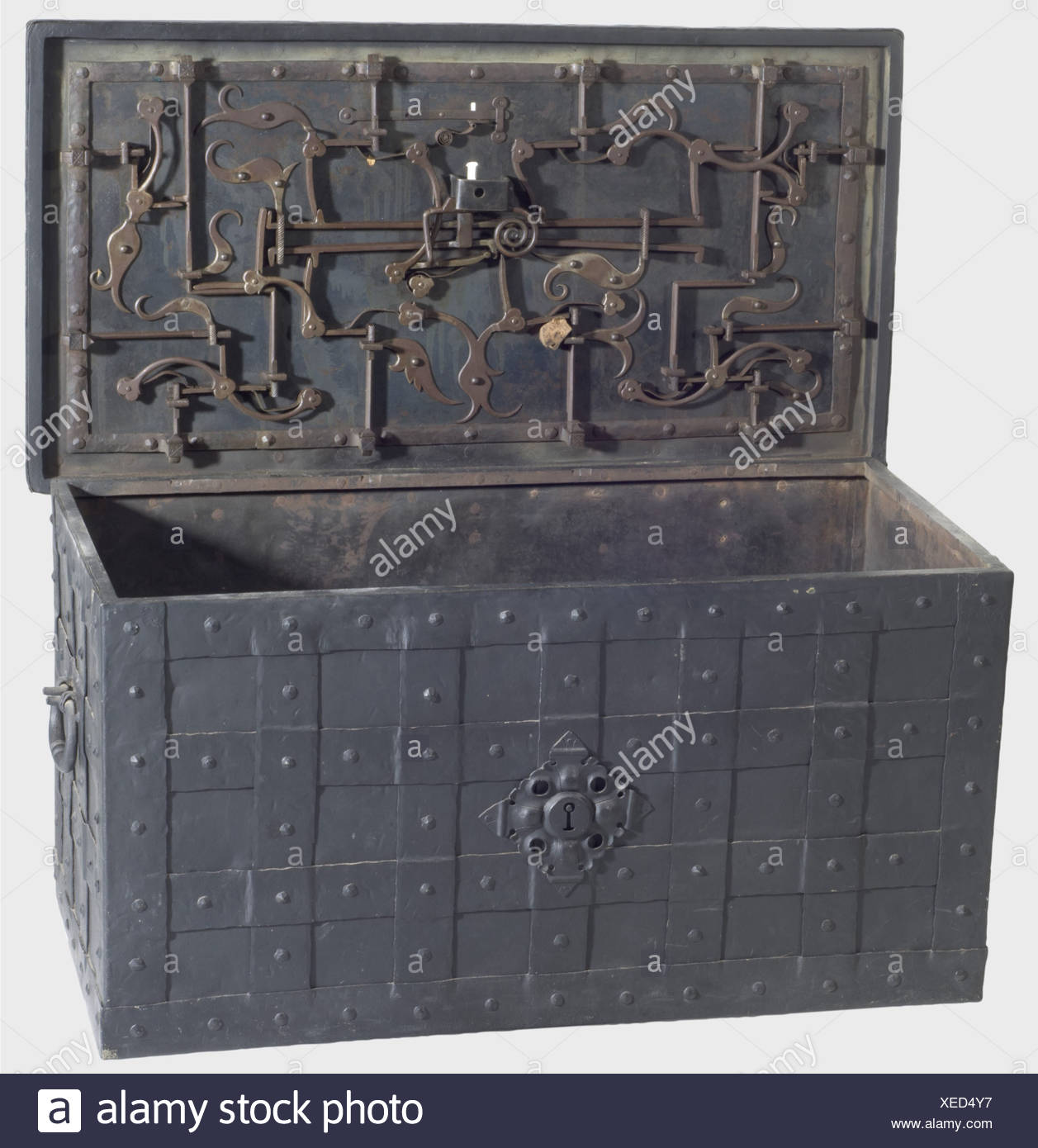 A large German war chest, 1st half of the 17th century. Iron chest reinforced with straps. Lateral handels and a false lock on the front. Lid with (supplemented) concealed keyhole cover, three hinges and twelve bolts. Later key. Dimensions 84.5 x 44.5 x 42 cm. historic, historical, 17th century, storage, box, boxes, cabinet, chest, cabinets, chests, piece of furniture, pieces of furniture, furnishings, object, objects, stills, clipping, clippings, cut out, cut-out, cut-outs, Additional-Rights-Clearances-NA - Stock Image