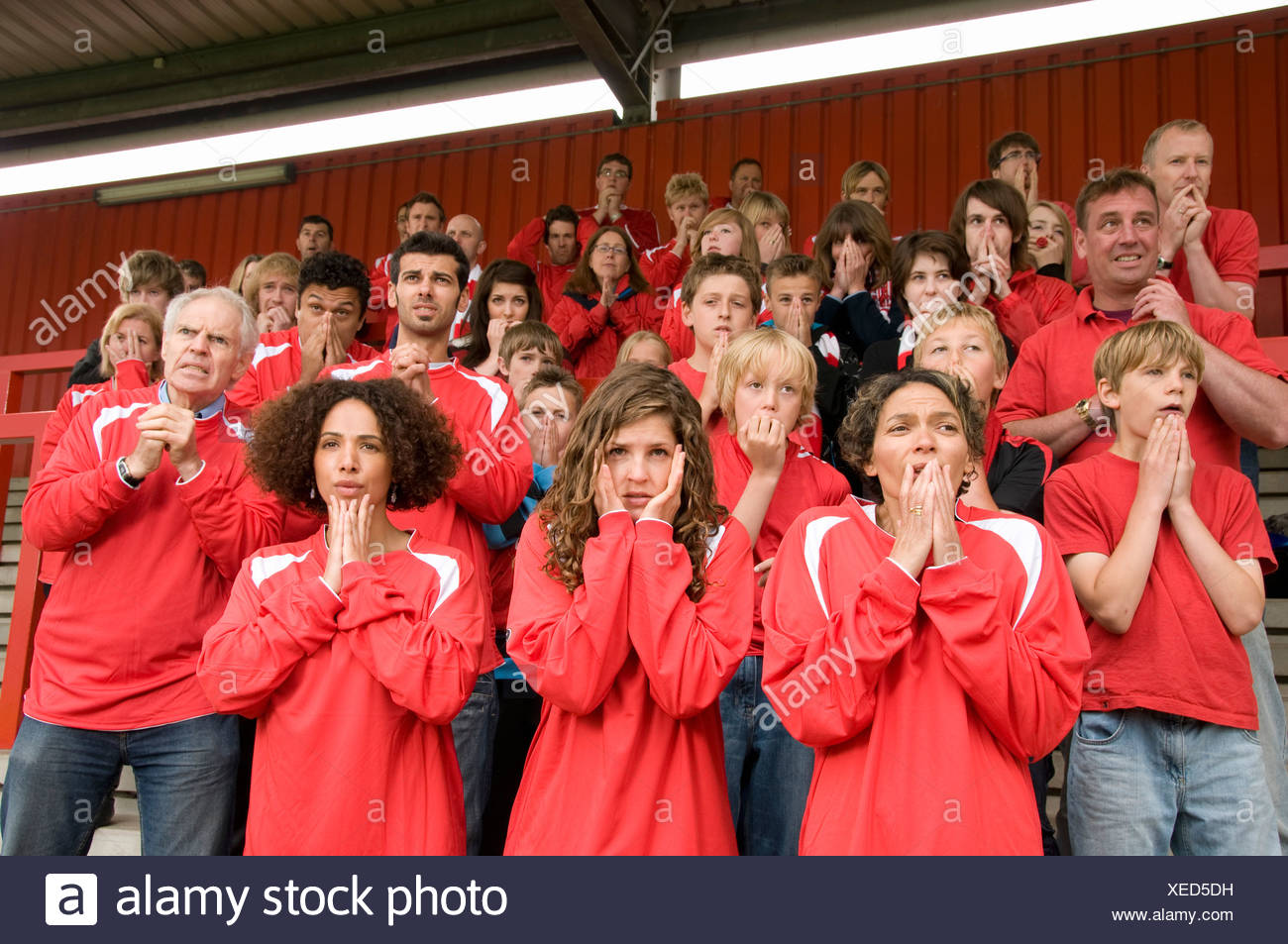 Group of nervous football supporters - Stock Image