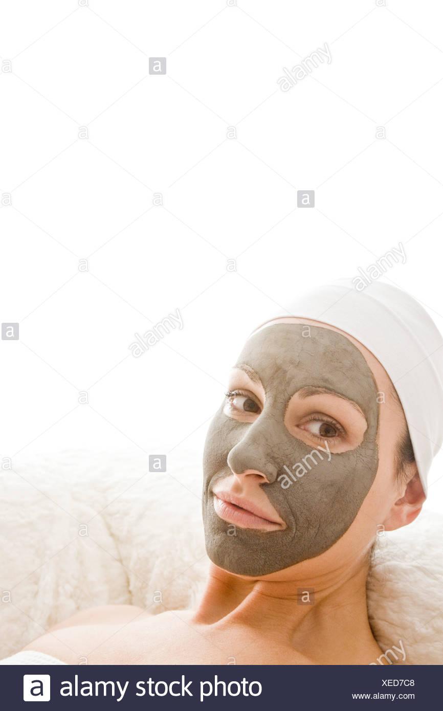 woman wearing beauty mask - Stock Image