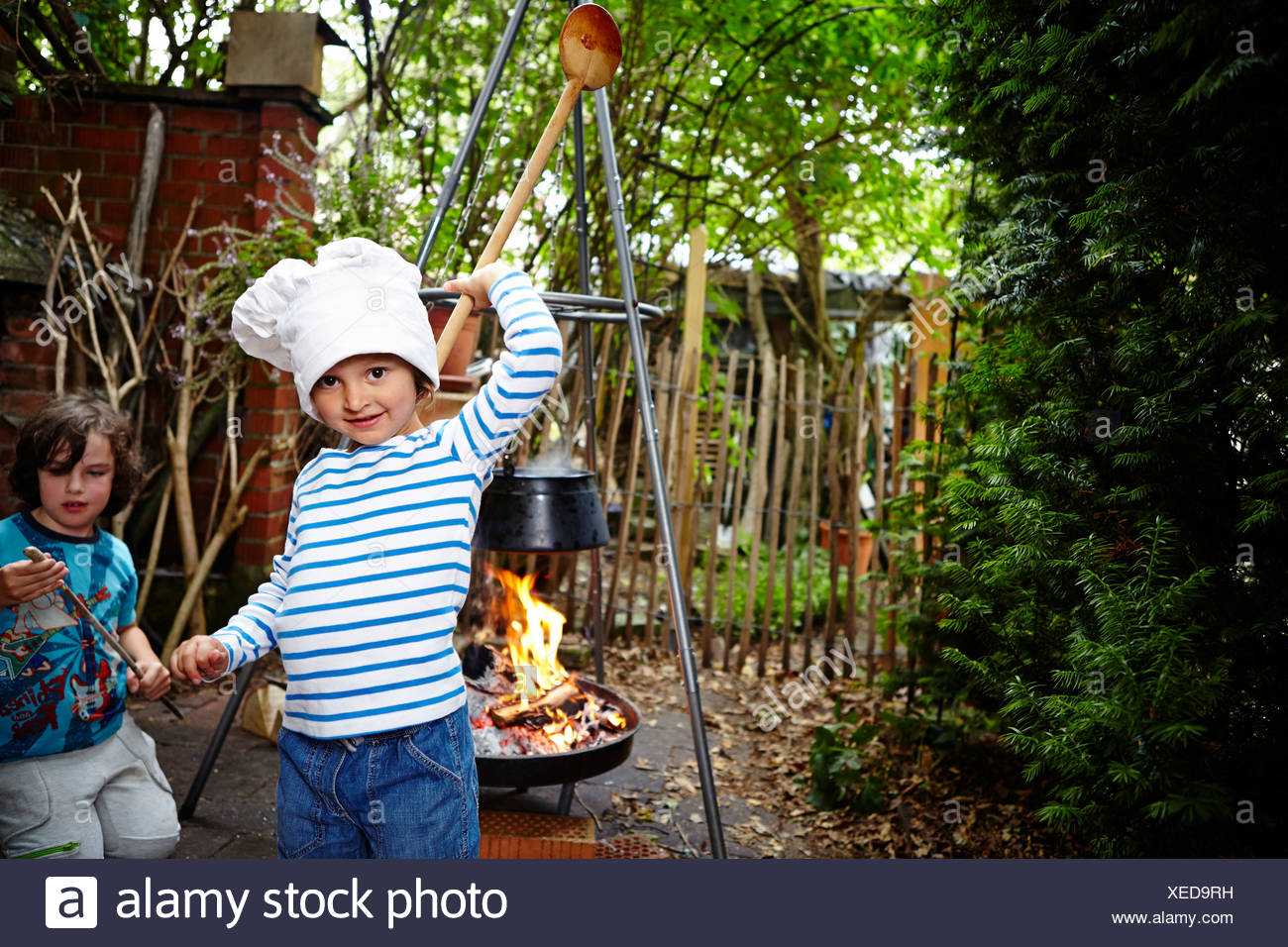 Little Girl Wearing Chef's Hat Stock Photo