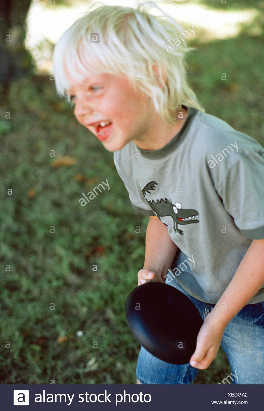 A young boy with a warp in hes hands. - Stock Image