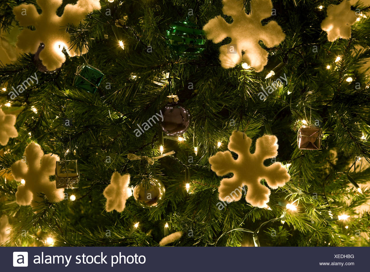 Christmas decorations on a tree - Stock Image