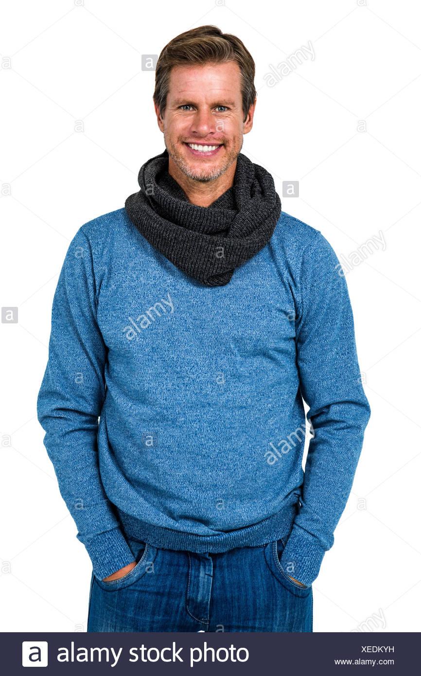 Stylish man standing against white background - Stock Image