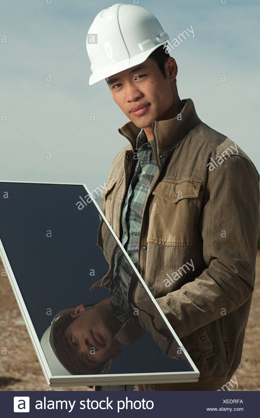 Man with solar panel - Stock Image