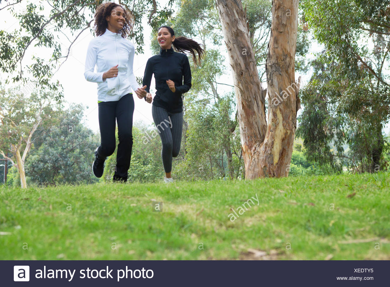 Young and mid adult woman jogging together Stock Photo