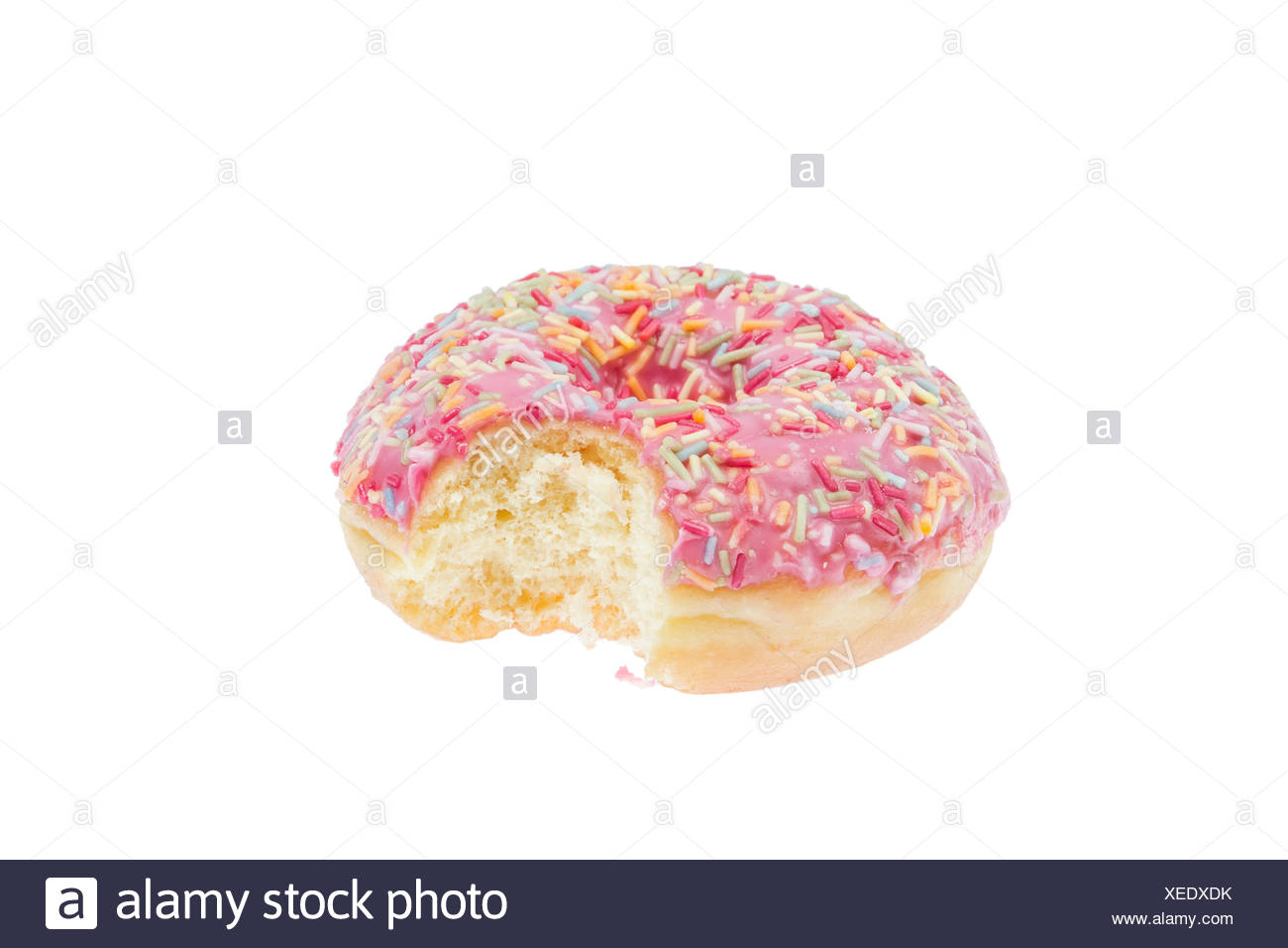 isolated donut with pink icing - Stock Image