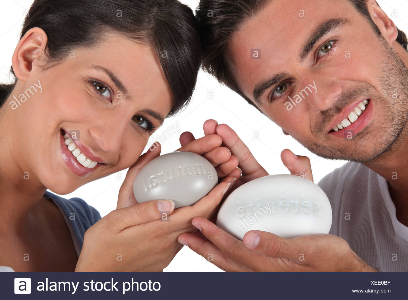 couple all smiles with bar of soap - Stock Image