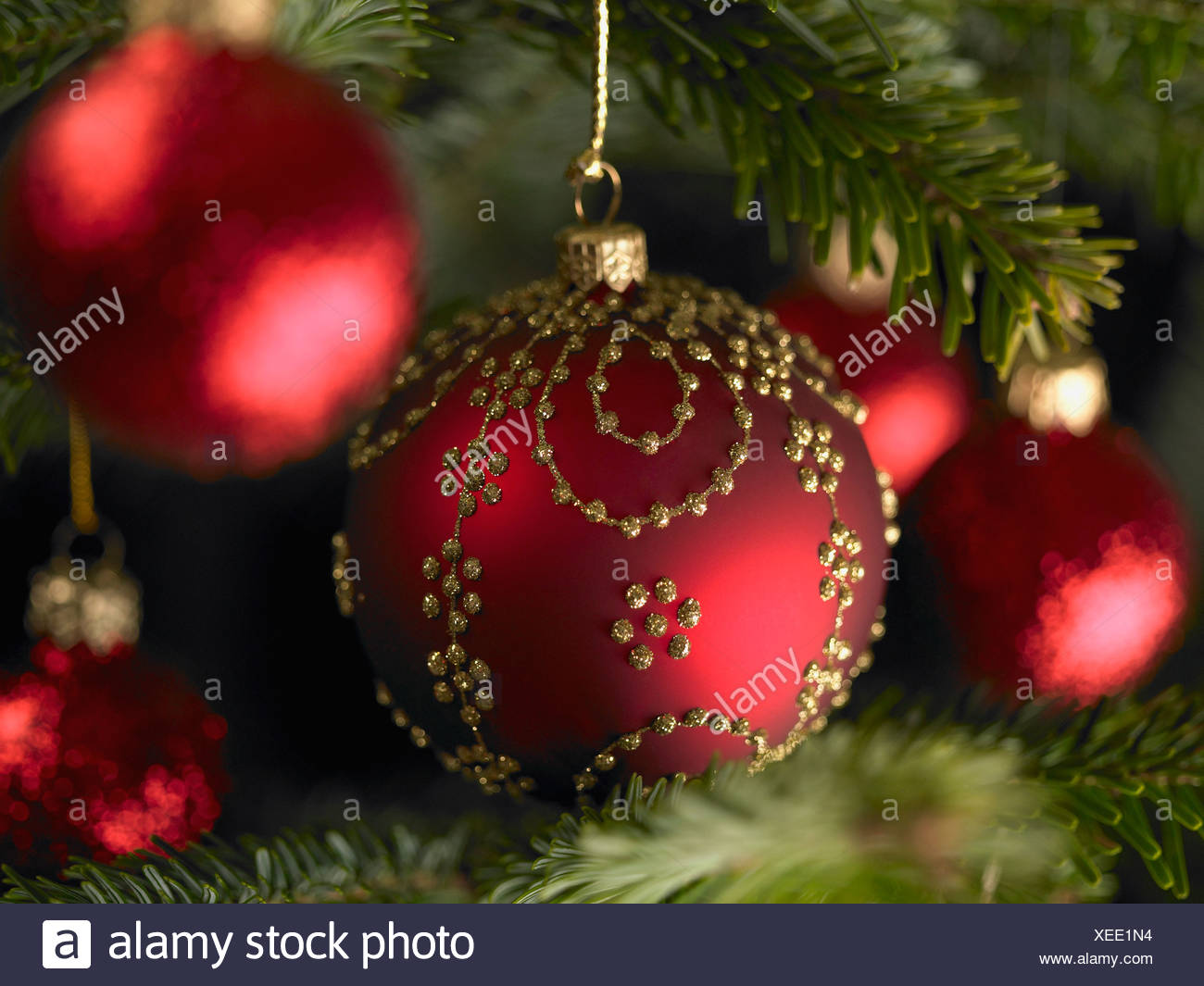 Close Up Of Red Christmas Ornaments On Tree Stock Photo 284279776