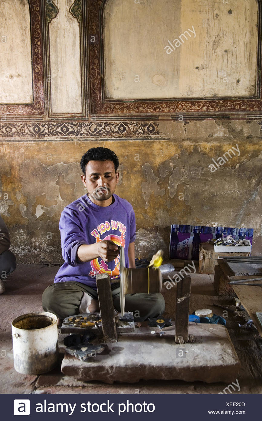 indian man grinds glass, North India, India, Asia - Stock Image