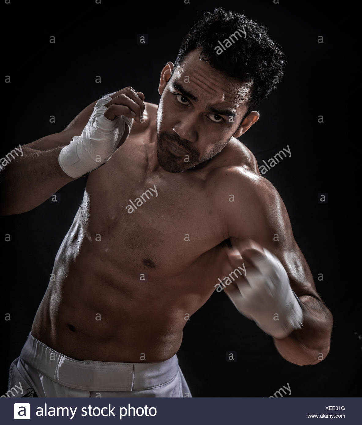 Male boxer punching - Stock Image