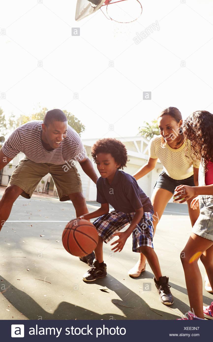 Family Playing Basketball Game At Home - Stock Image