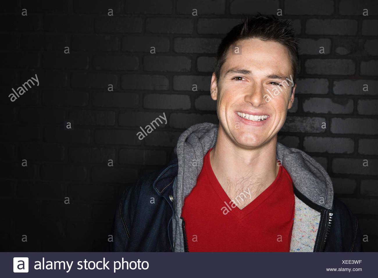 Portrait of smiling brunette man wearing jacket Stock Photo