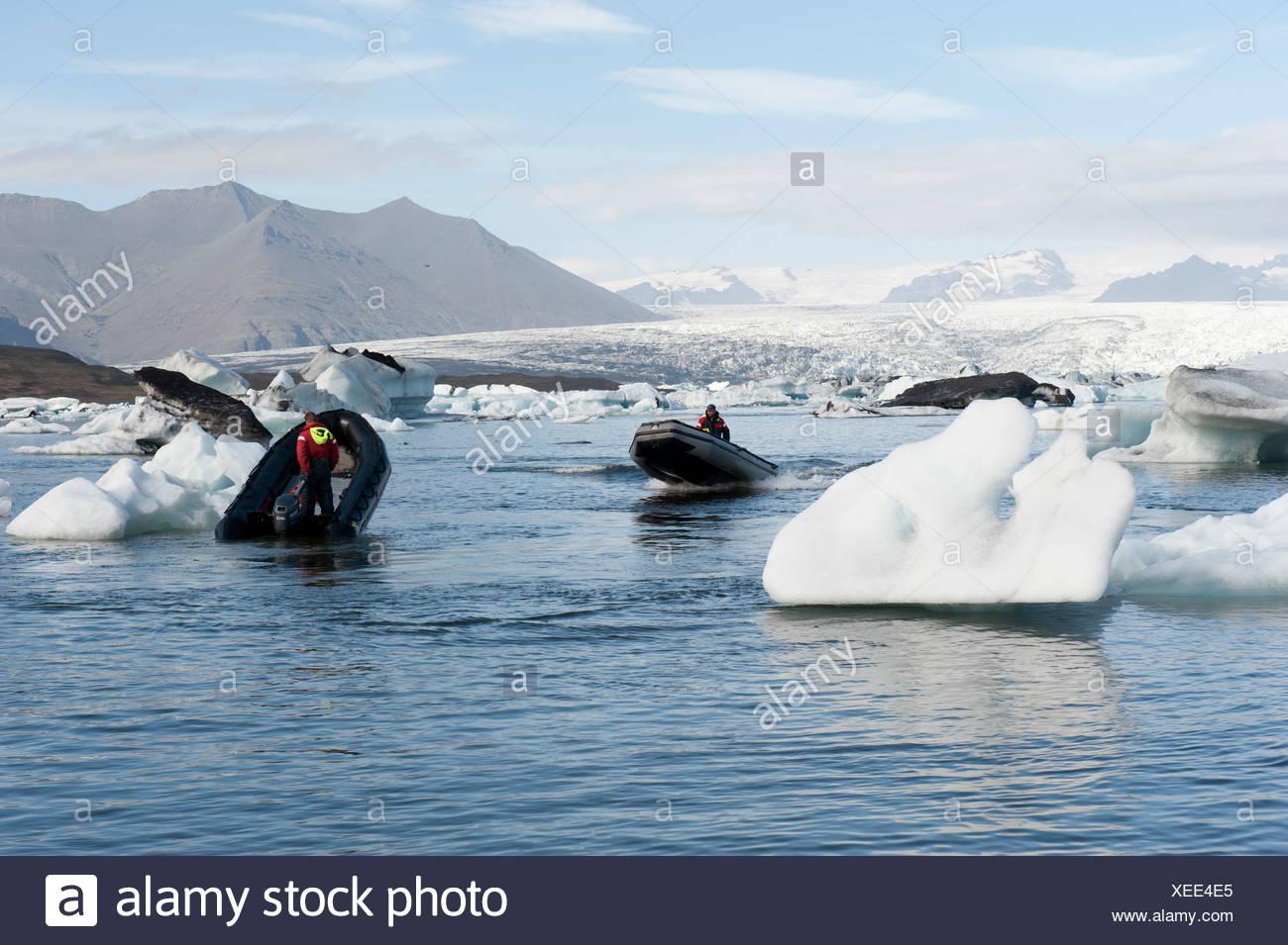 Motor boats, inflatable boats between icebergs, Joekulsárlón glacial lake, Joekulsarlon, Iceland, Scandinavia, Northern Europe - Stock Image