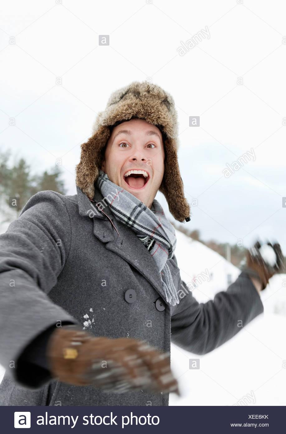Man throwing snowball - Stock Image
