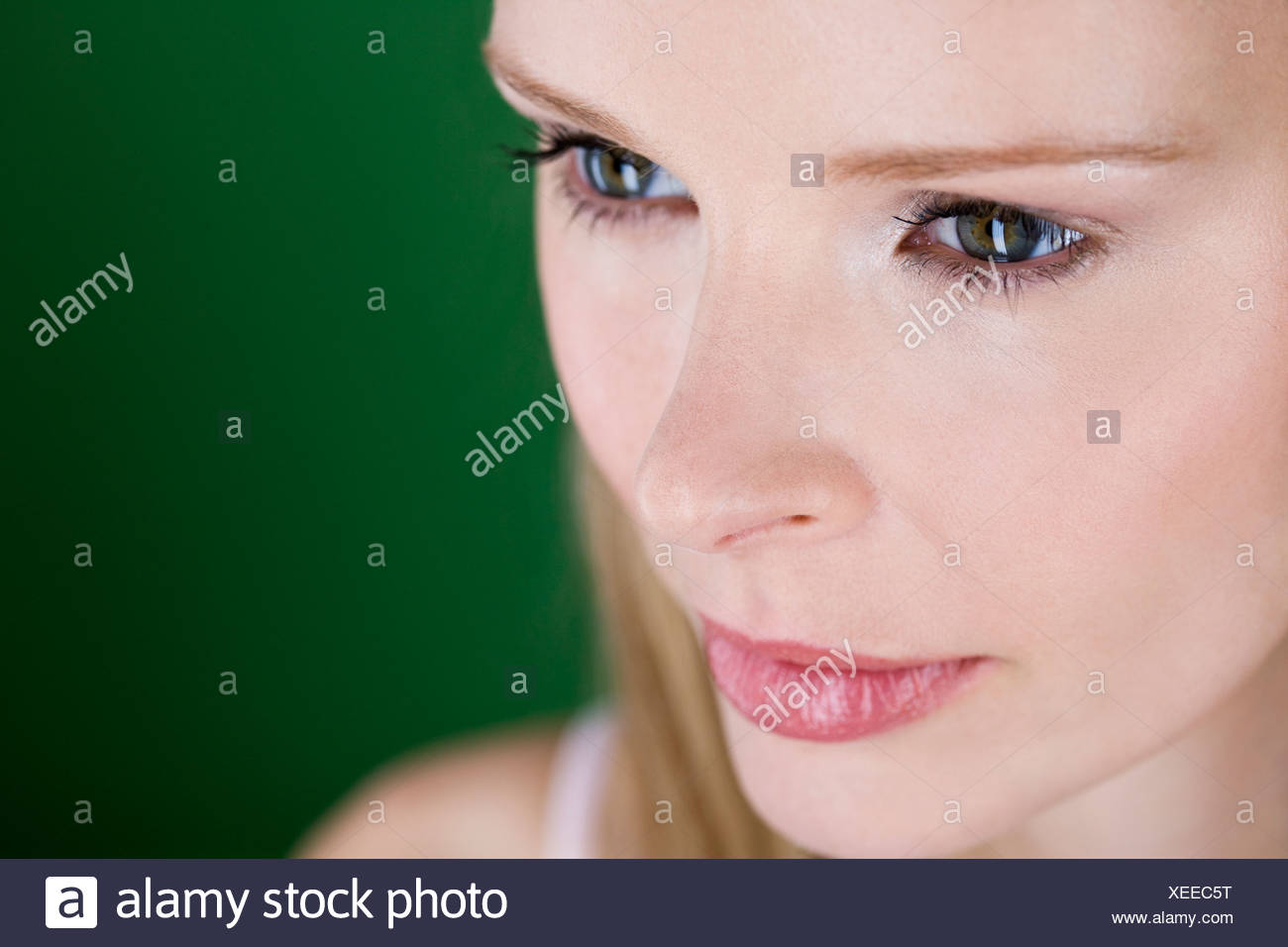 A portrait of a young woman thinking - Stock Image