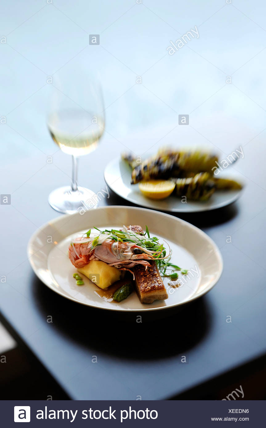 Still life with prawn, potato and micro greens - Stock Image