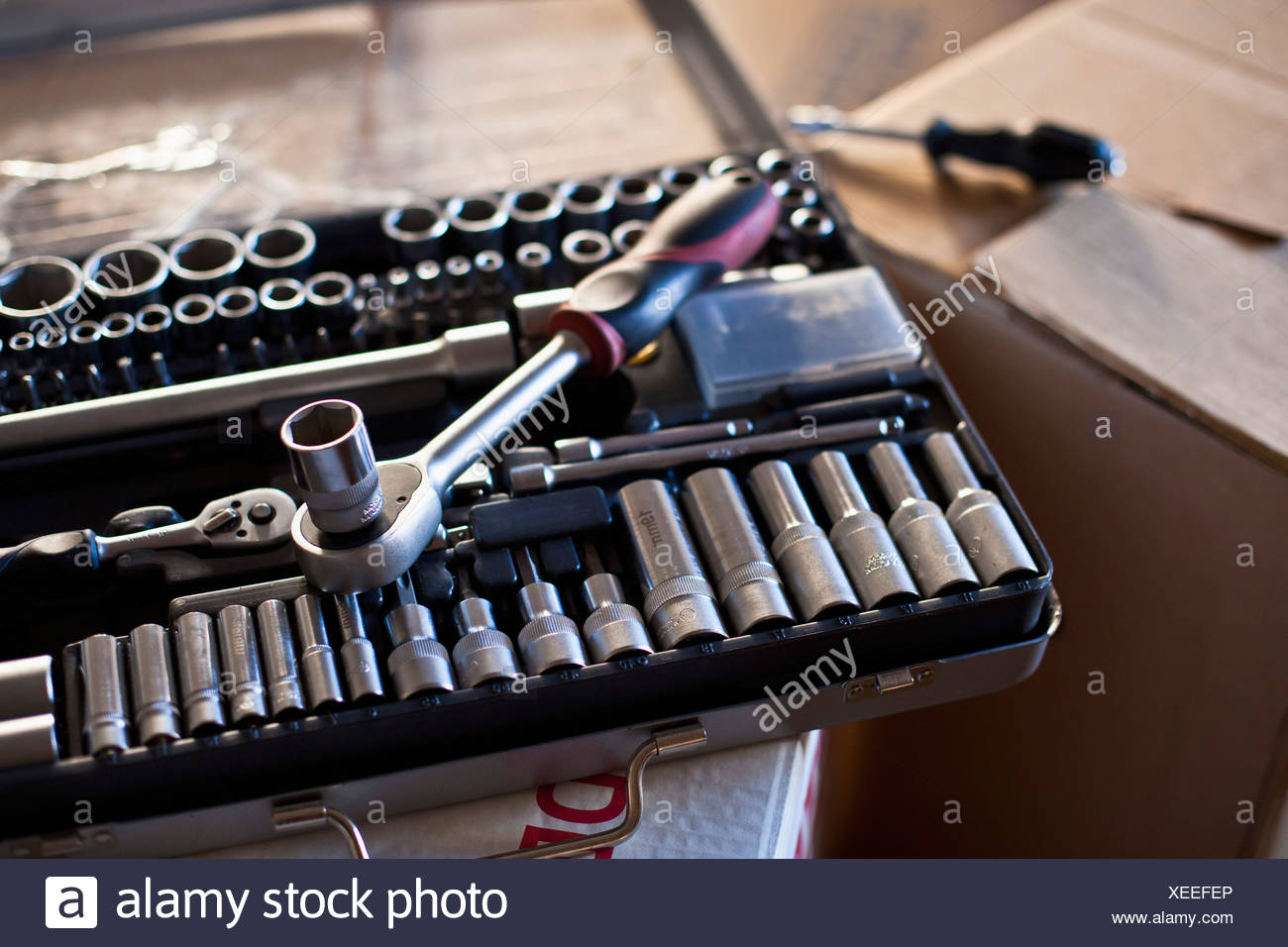 Tool box on cardboard box - Stock Image