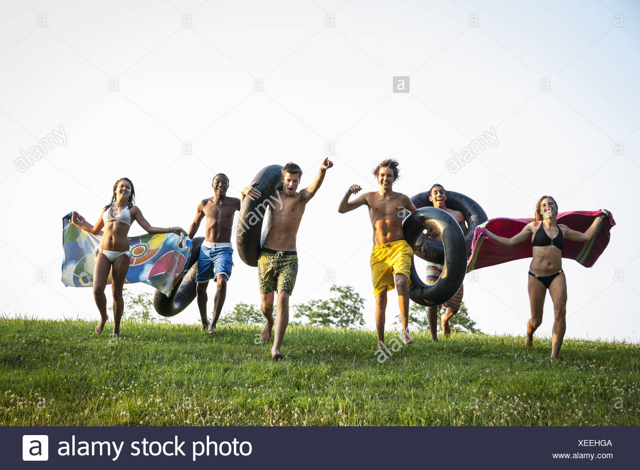 Maryland USA teenagers boys and girls running across the grass Stock Photo