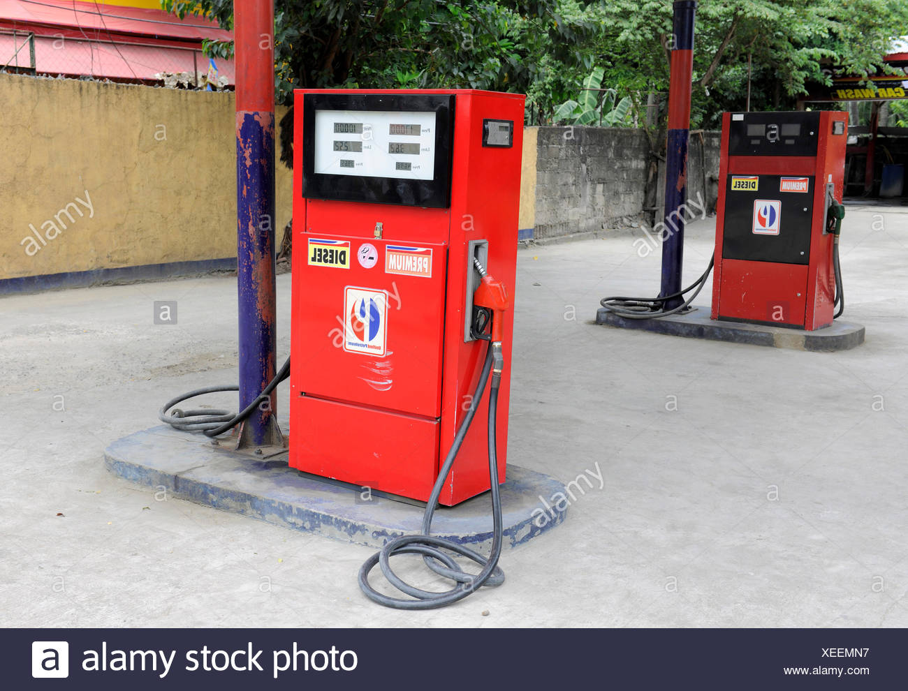 Red fuel pumps, Cebu, Philippines, Southeast Asia, Asia - Stock Image