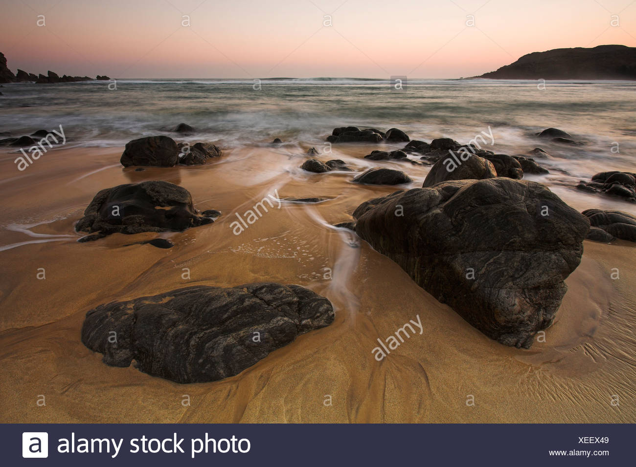 Rocks and sunset at Dhail Mor beach, Lewis, Outer Hebrides - Stock Image