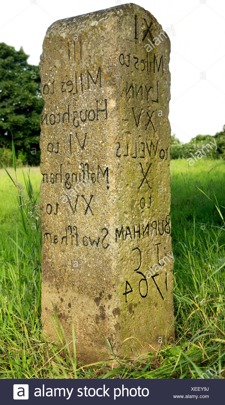 Milestone dated 1764, Anmer, Norfolk, mileage to Houghton, Massingham, Swaffham, Kings Lynn, Wells, Burnham.  Initials 'J.C.' - Stock Image