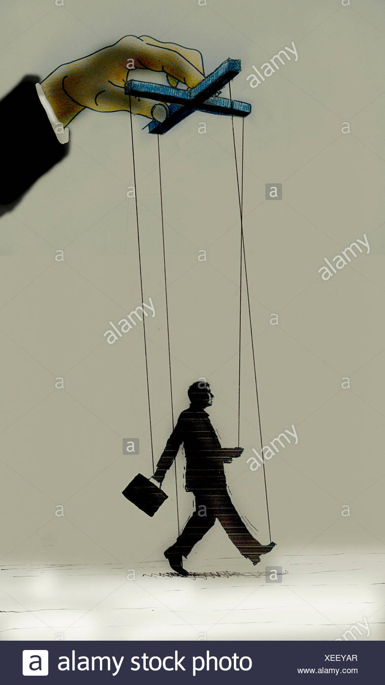 Hand controlling strings of puppet businessman - Stock Image