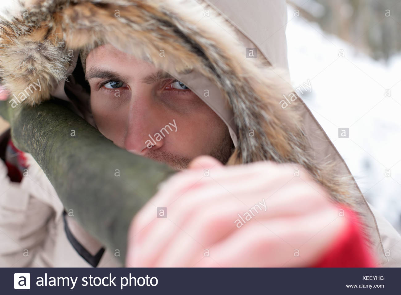 Young man with a fur hood - Stock Image