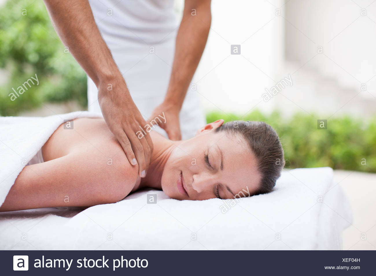 Woman receiving massage - Stock Image