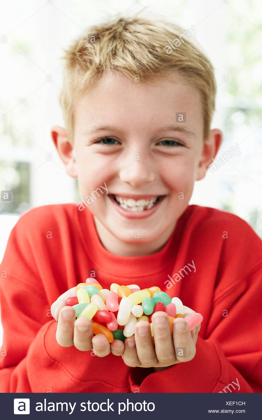 Boy holding sweets. He is six years old. Stock Photo