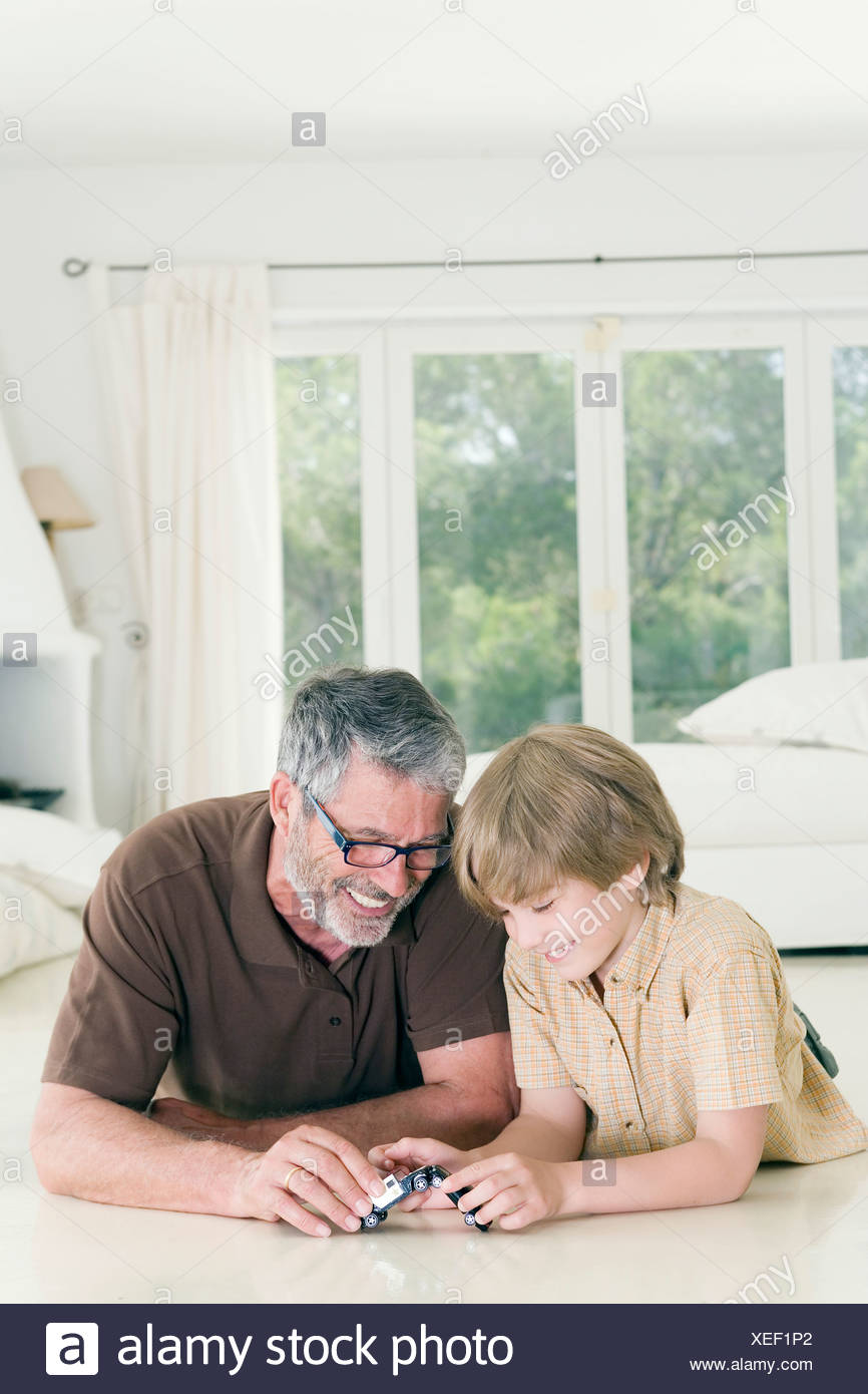 Man and child playing together - Stock Image
