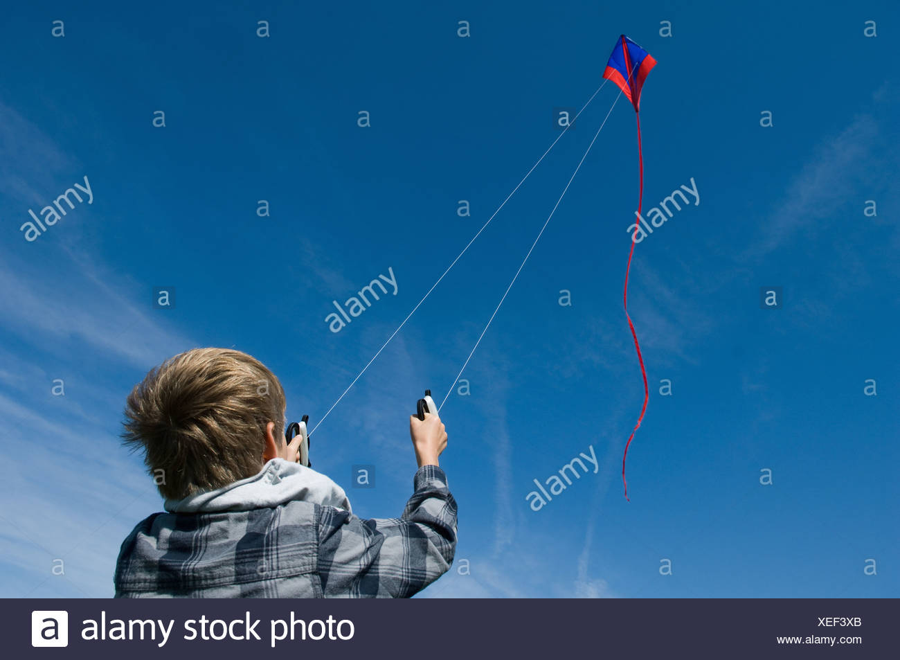 Boy flying a kite - Stock Image