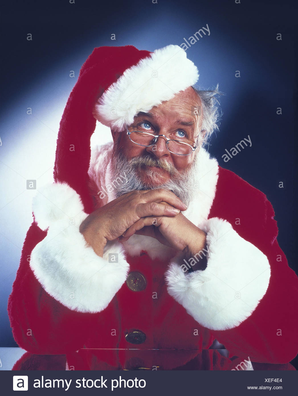 Santa Claus, gesture, desperation, half portrait, Christmas, yule tide, Santa, exhausts, raise the eyes thoughtful, helplessly, think, dealts with, consider, doubtful, studio - Stock Image