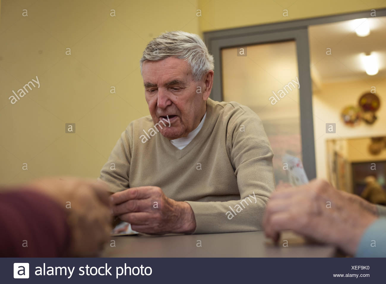 Senior man playing cards - Stock Image