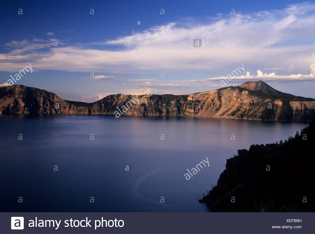 Crater Lake with moon near Pumice Point, Crater Lake National Park, Oregon. - Stock Image