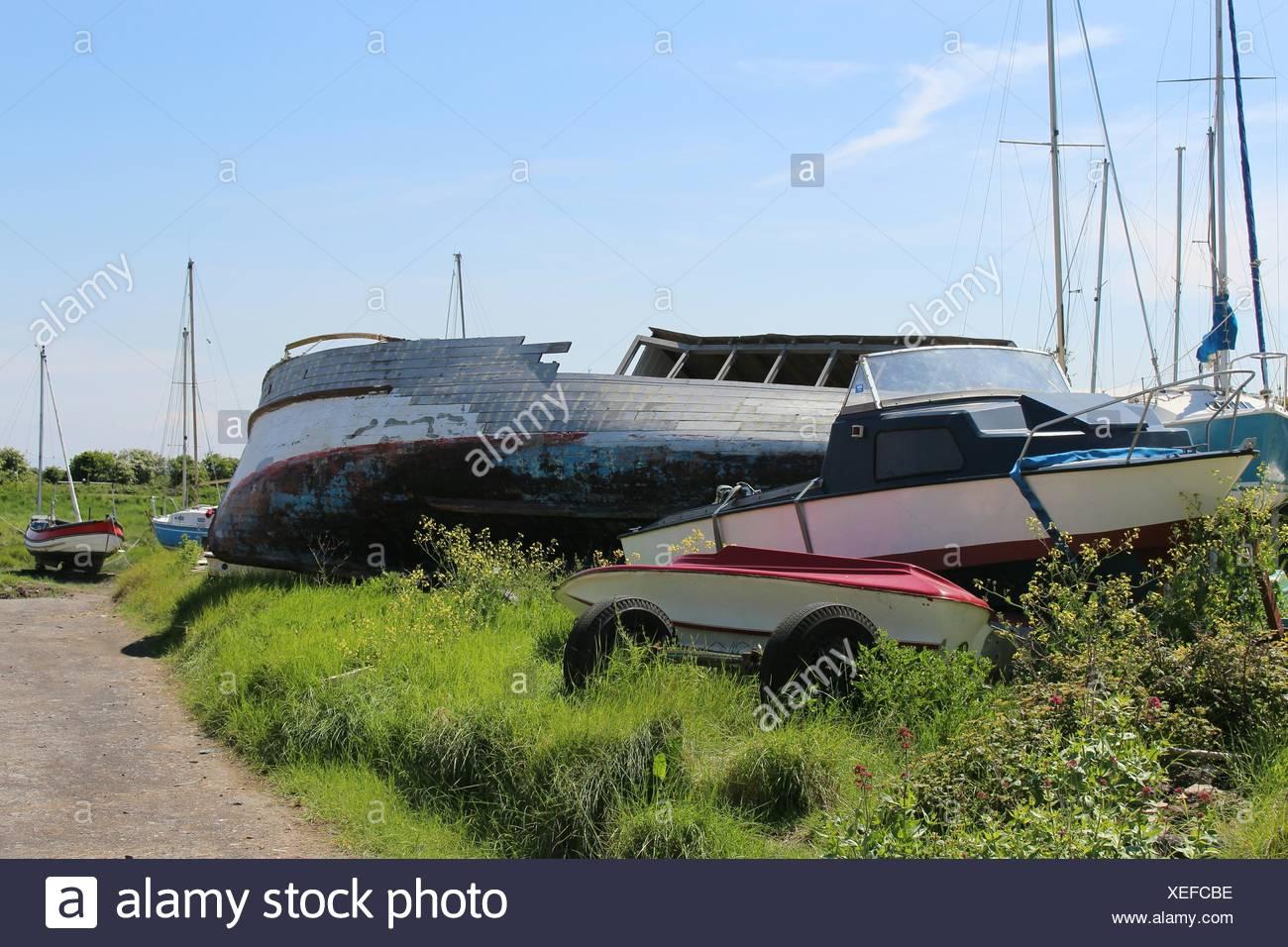 Old Boats In Junkyard - Stock Image