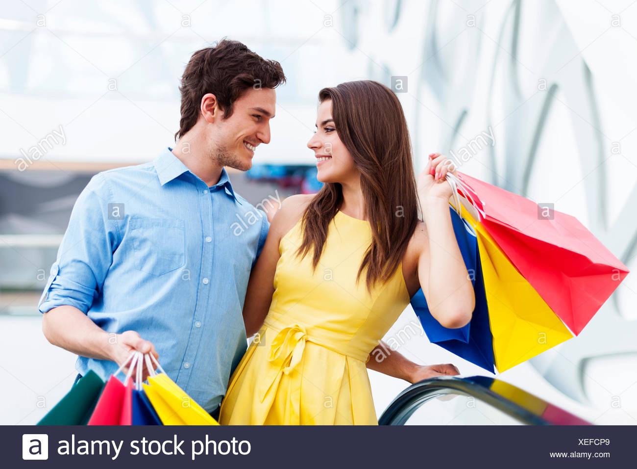 Conversing couple on shopping Debica, Poland - Stock Image