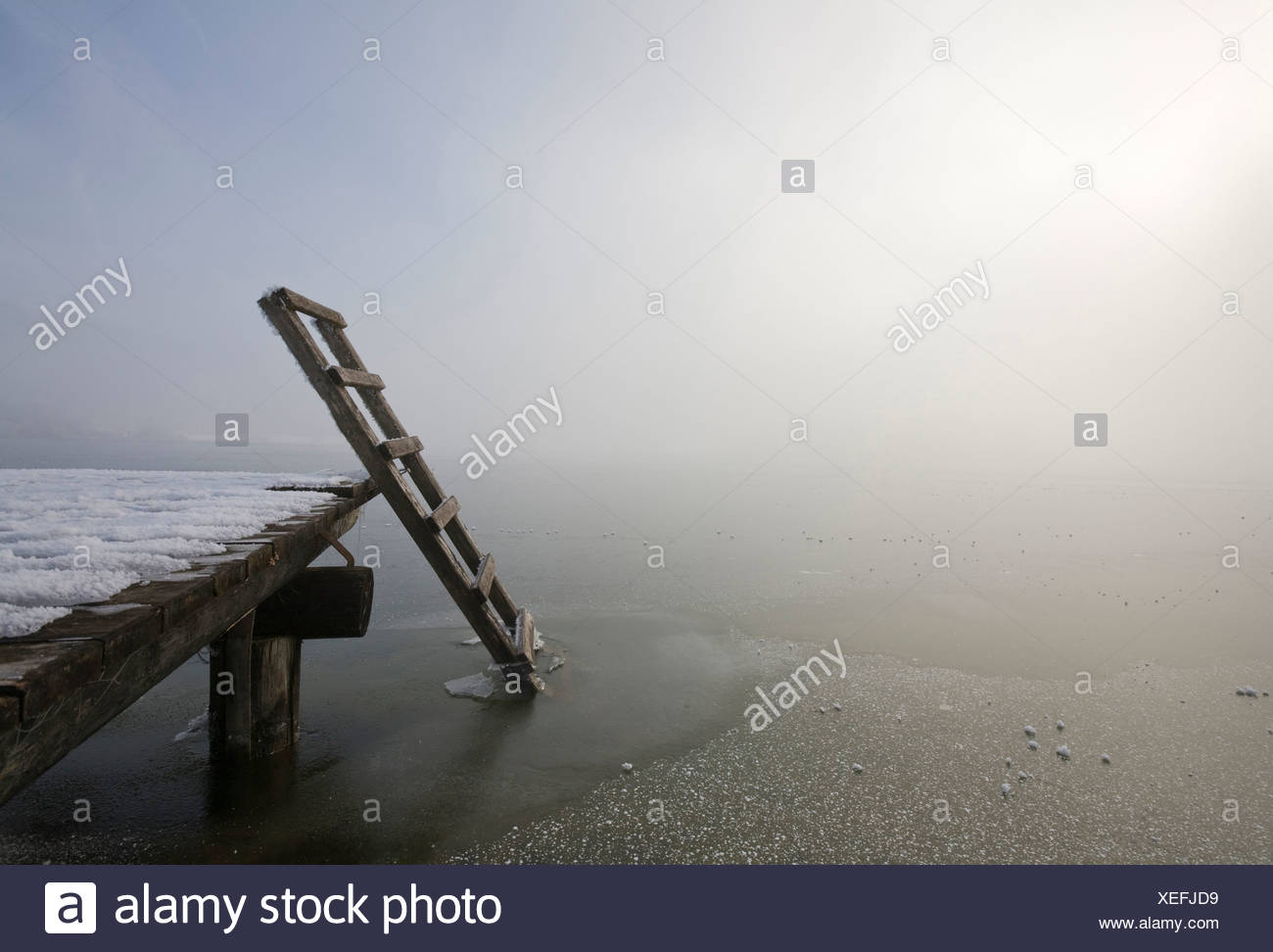 Germany, Bavaria, Murnau, Wooden jetty on lake - Stock Image