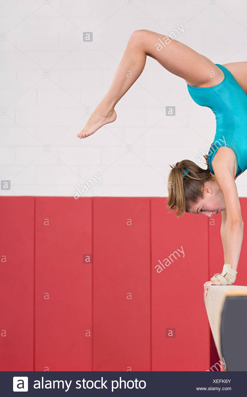 Gymnast on a balance beam - Stock Image