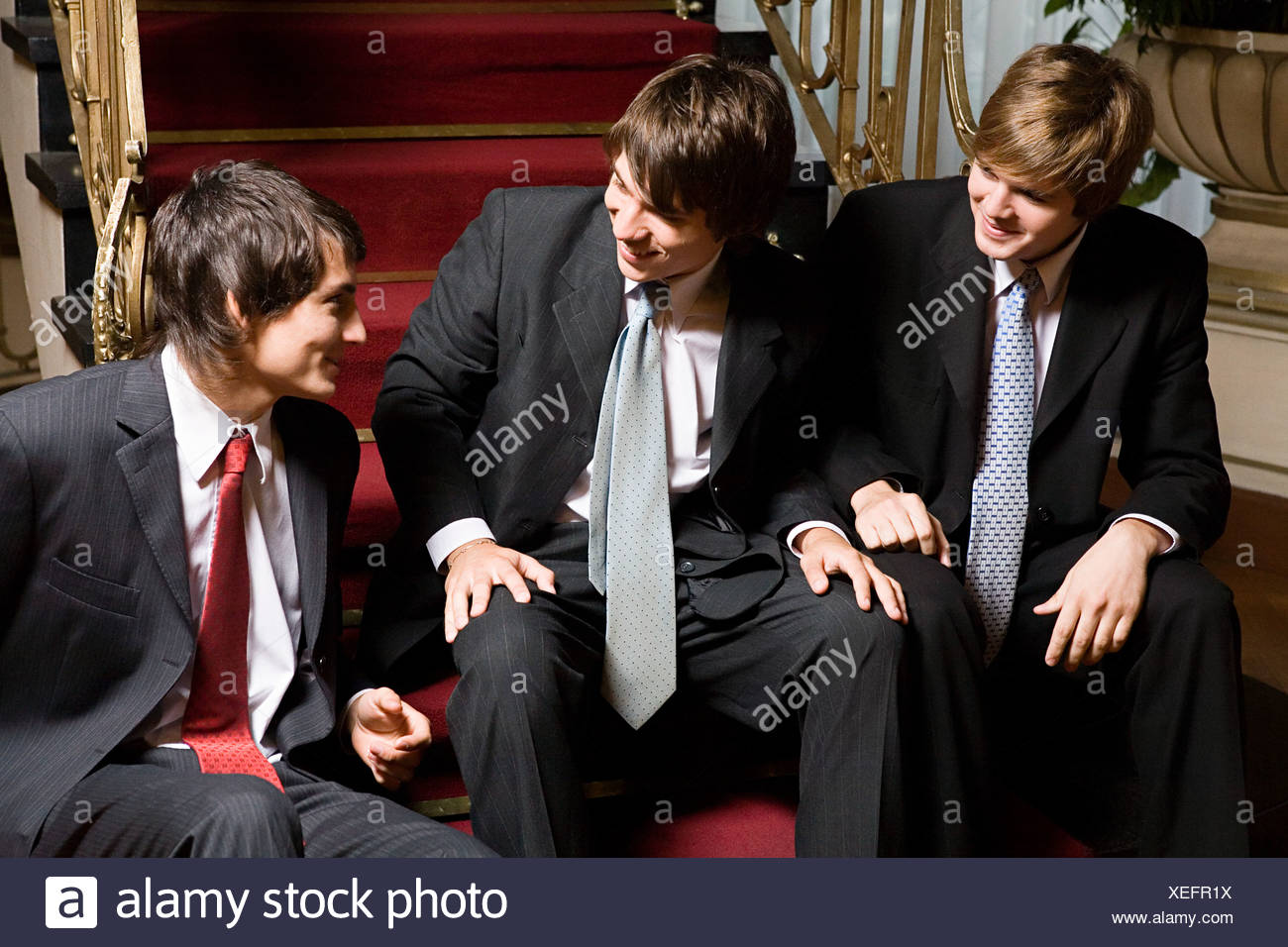 Teenage boys wearing suits - Stock Image