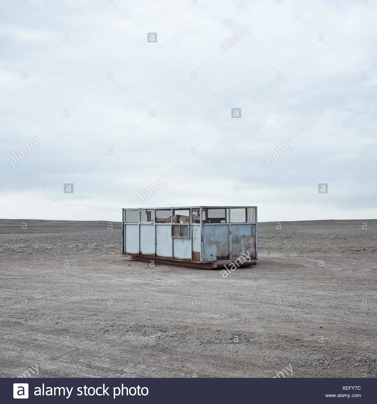 USA, Wyoming, Garbage container on prairie - Stock Image