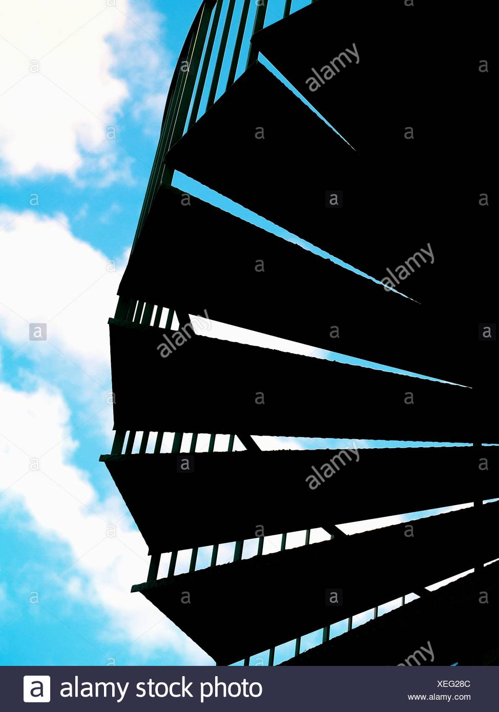 Low Angle View Of Silhouette Steps Against Cloudy Sky - Stock Image
