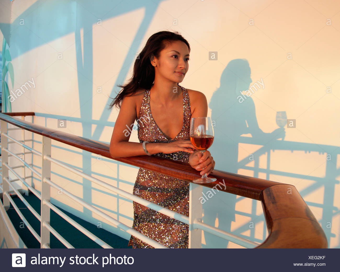 Chinese woman in evening wear on cruise ship Stock Photo: 284324419 ...