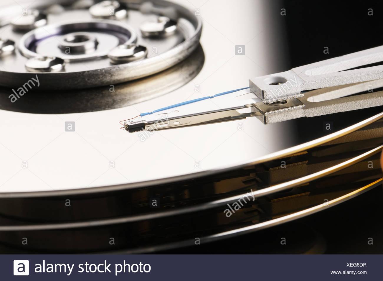 Taken apart computer hard disk drive backround - Stock Image