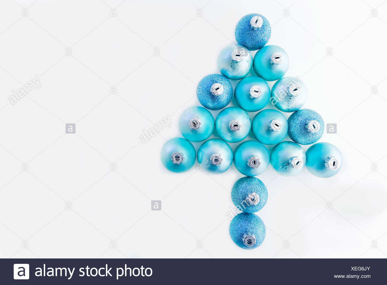 Christmas tree made of blue christmas baubles - Stock Image