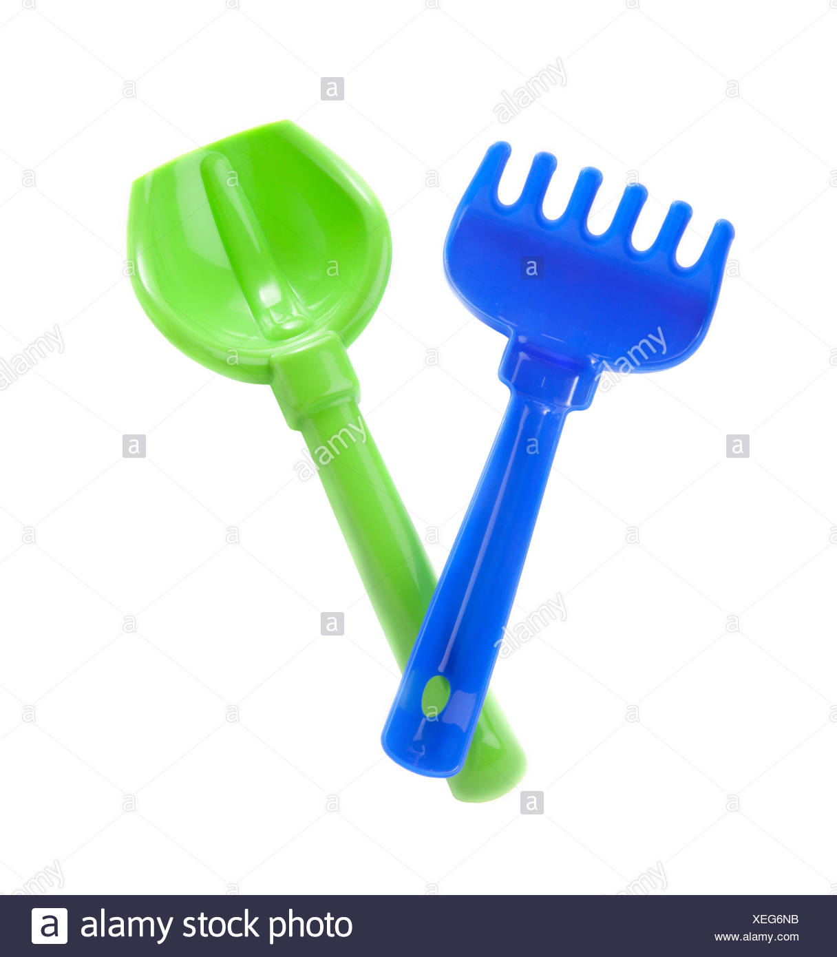 blue rake and green spade over whitebackground - Stock Image